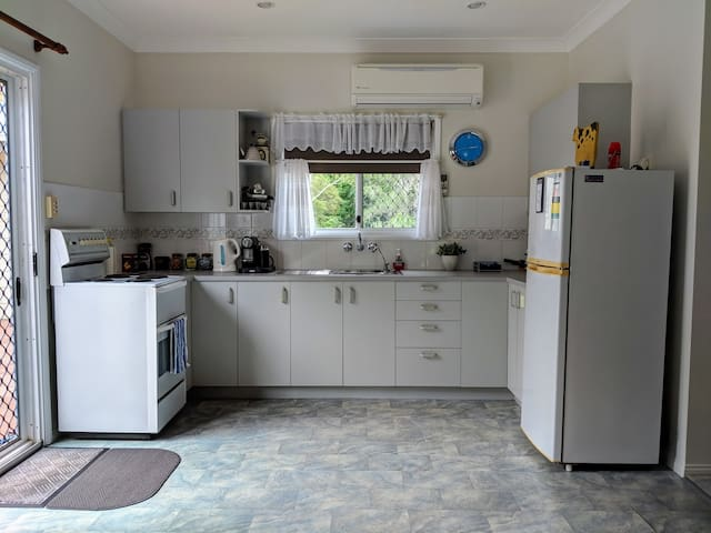 Fully equipped kitchen including stove, oven, microwave and Nespresso coffee machine.