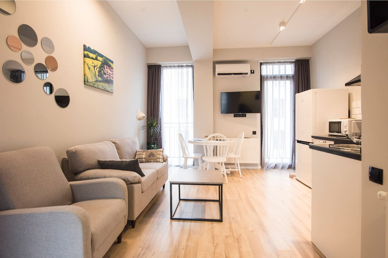 Studio type living room with a balcony
