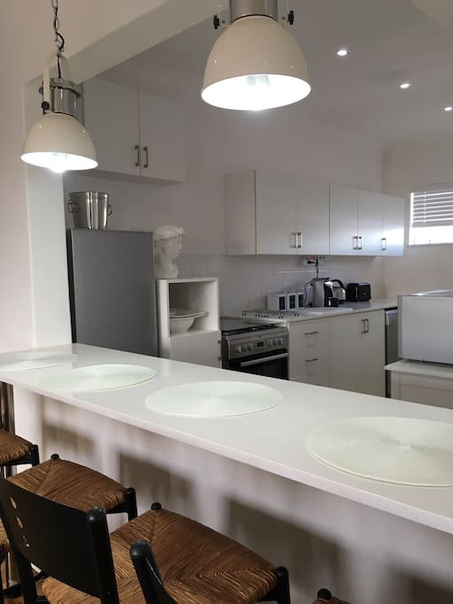 Kitchen with gas stove, dishwasher, microwave and coffee machine