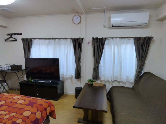 Triple room has sofa bed, two single beds, TV, desk&chair, low table and big refrigerator.