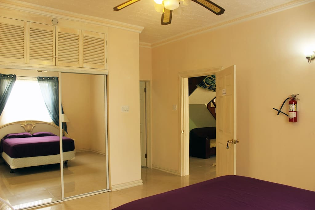 Queen size bed with AC, fan, walking closet and private bathroom