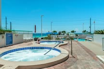 Dual hot tubs and pool at Surfside