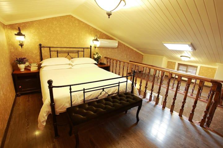 鼓浪屿花房旅馆舒适复式1.5米床203桑提亚