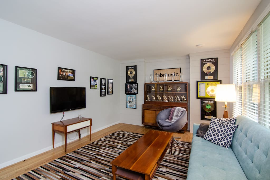 The Grammy-lined living room includes a flat-screen TV with full cable access.