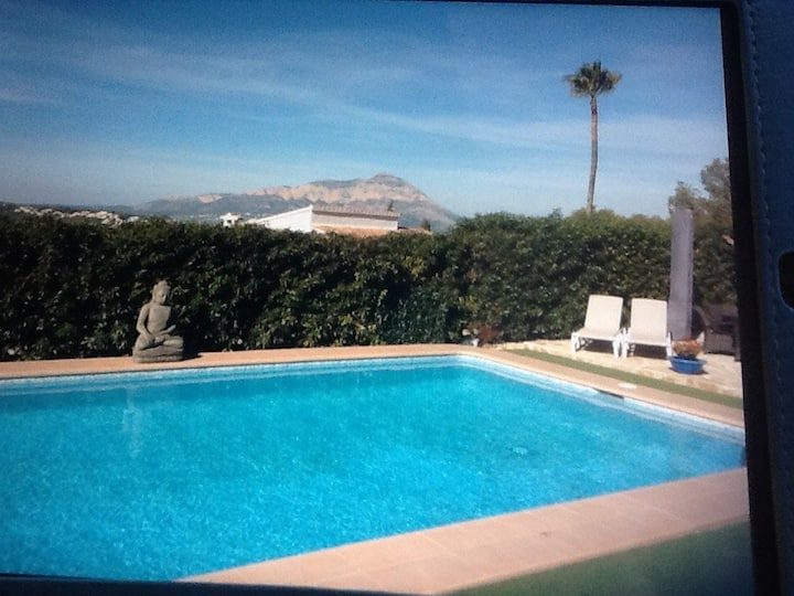 Private studio above villa with pool & great views