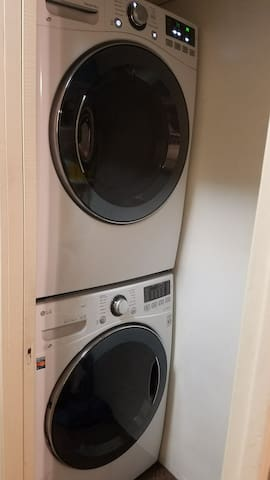 New LG front loading washer&dryer, located in kitchen.