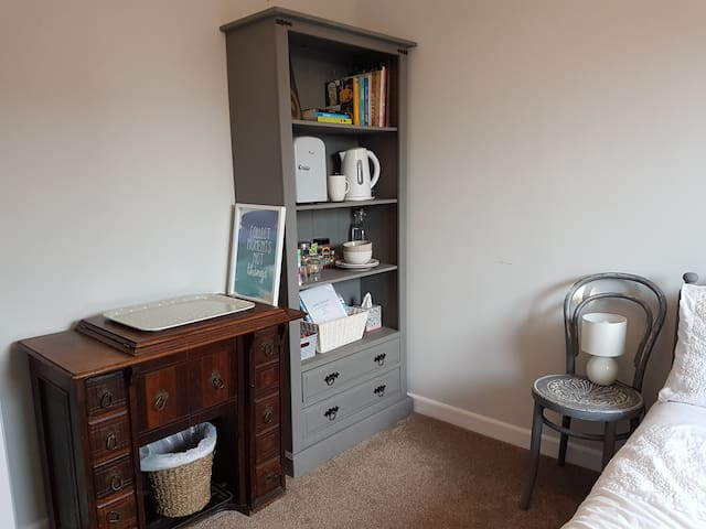Shelving unit with two drawers for your possessions.