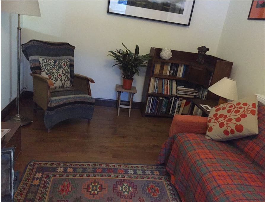 The cosy front room has an oak floor, a dining table and comfy seats
