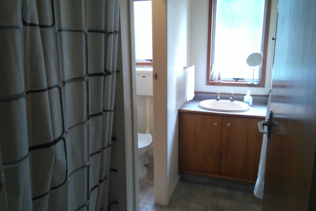 Bathroom & toilet, 70's shub style shower (shitty plastic never looks clean though) You'll need your own toiletries and this is also where the 1st aid kit is.