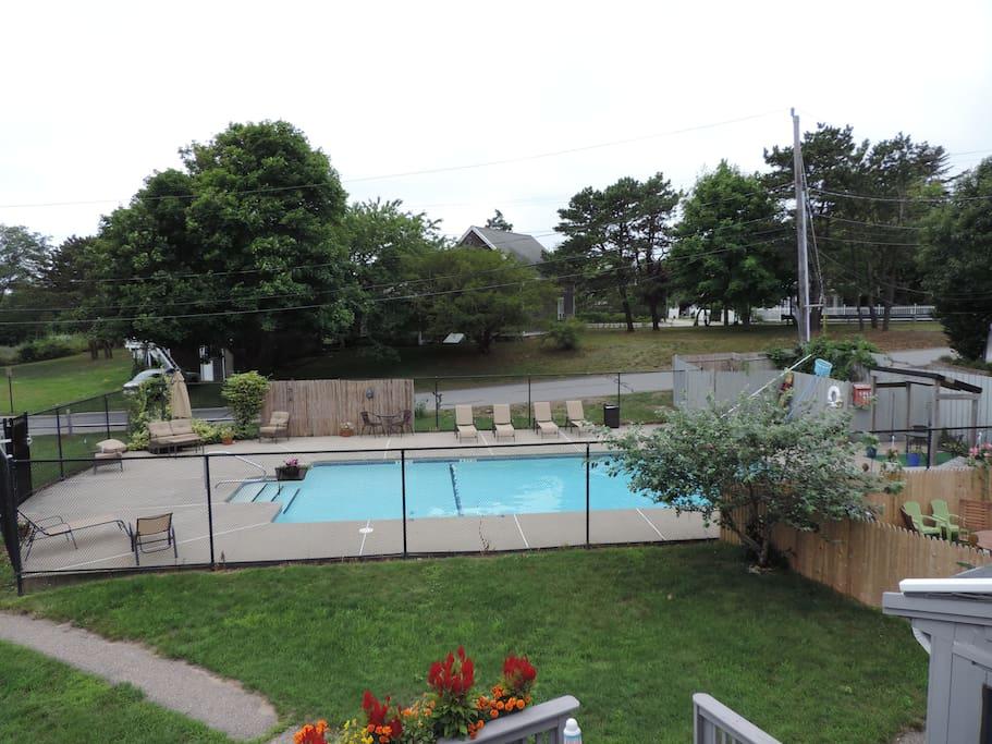 Seasonal heated pool just steps from unit.