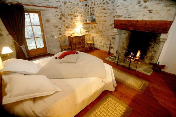 Chambre Romantique avec feu de cheminée