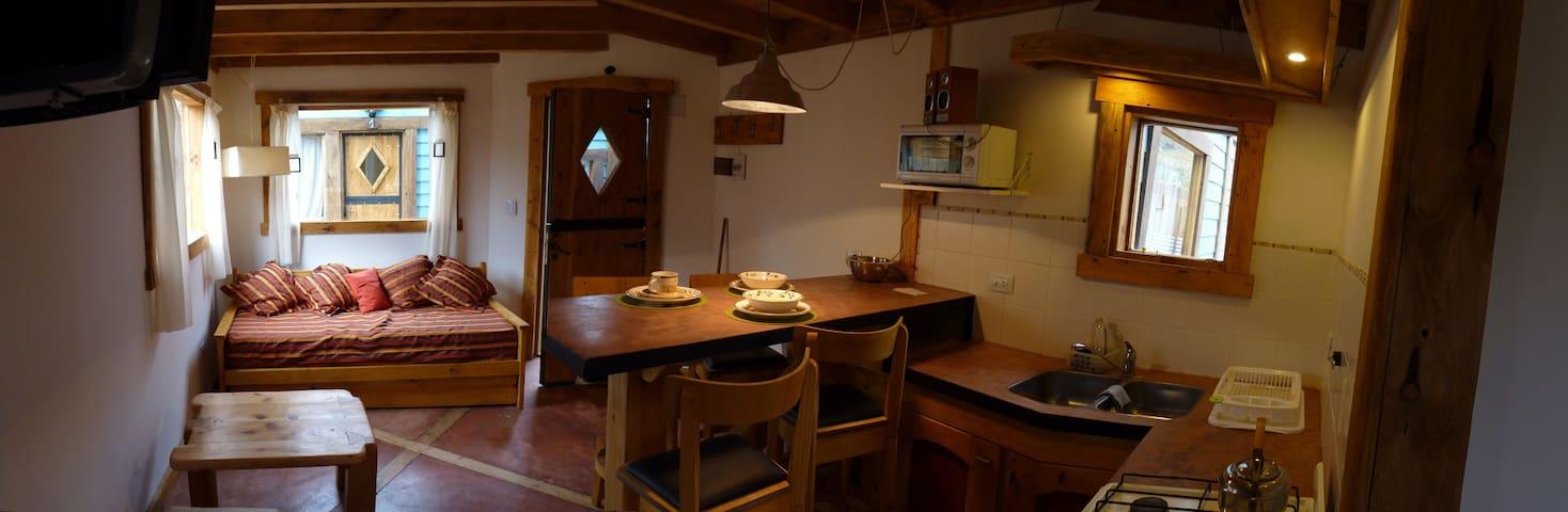Calidos living comedor con cocina completa tv plana satelital y hermosas vistas