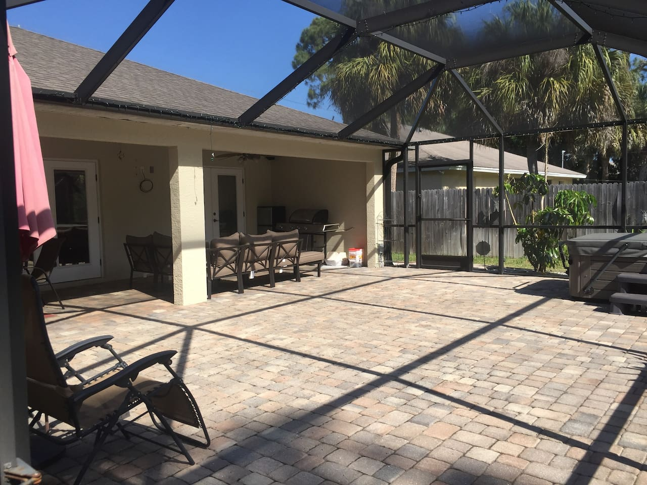 30' x 31' screened lanai with covered patio, plenty of relaxing space and therapeutic hot tub.