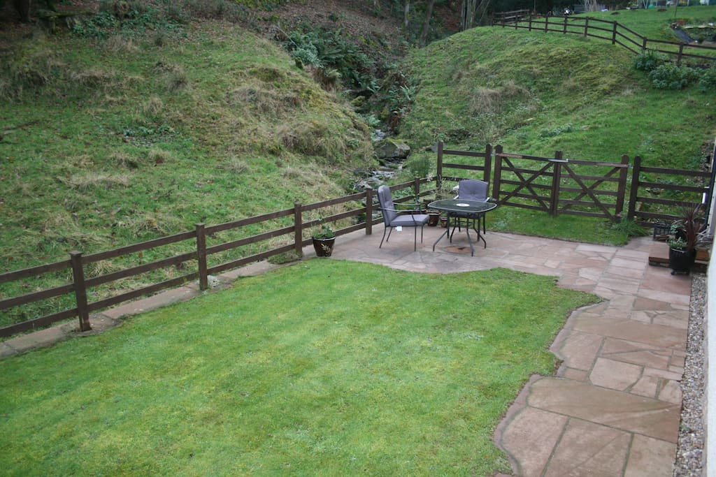 Private Lawn & Patio with Bistro Table & Chairs with the sound of the stream running by