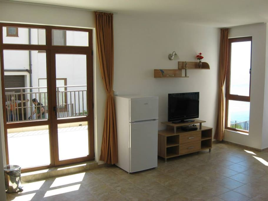 Living room with sea views, a kitchenette and a sofa bed. Satelite TV and wireless Internet