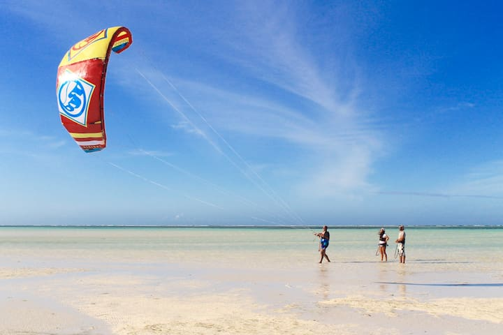 Kite lessons, rental and free ride at my beach club.