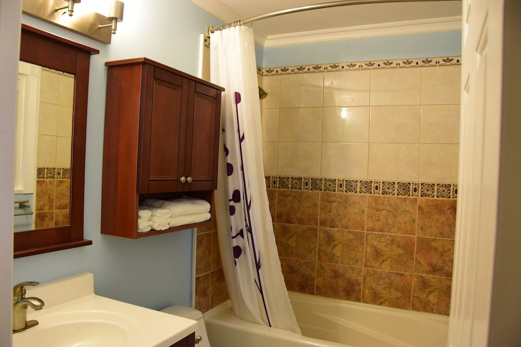 Private bathroom with bathtub, all essentials included (shampoo, towels, hairdryer, cups, etc.)