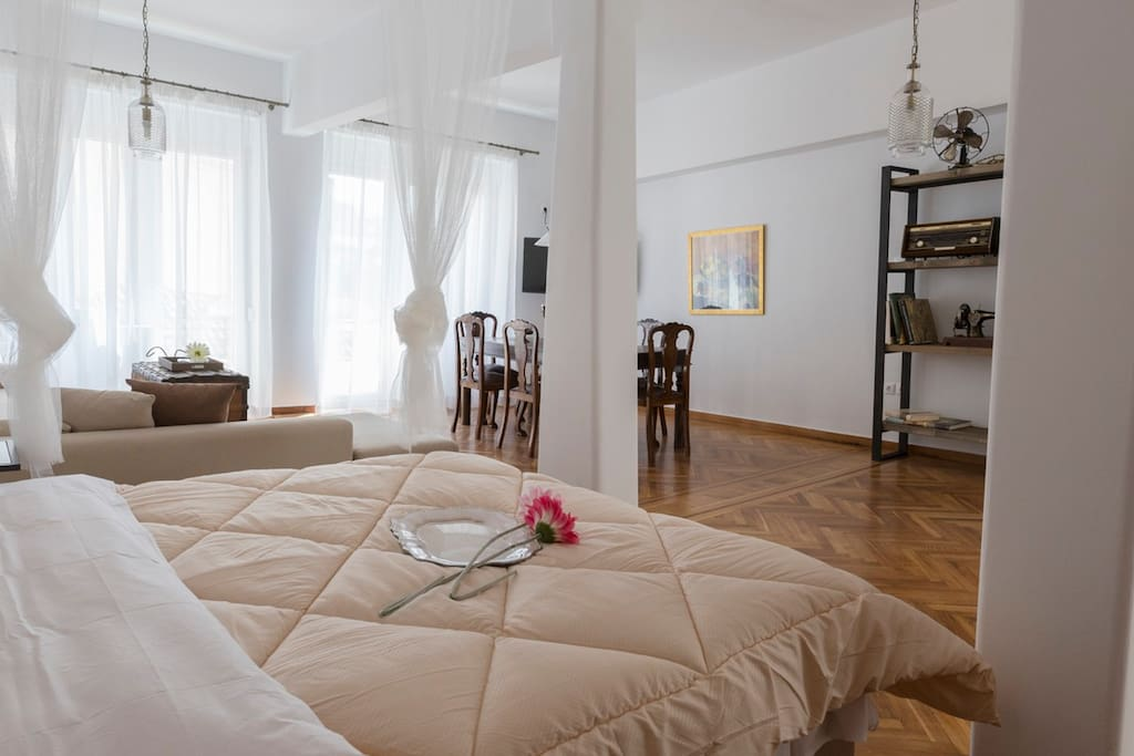 Very large living room with lounge, dining room and cleverly fashioned bedroom space.