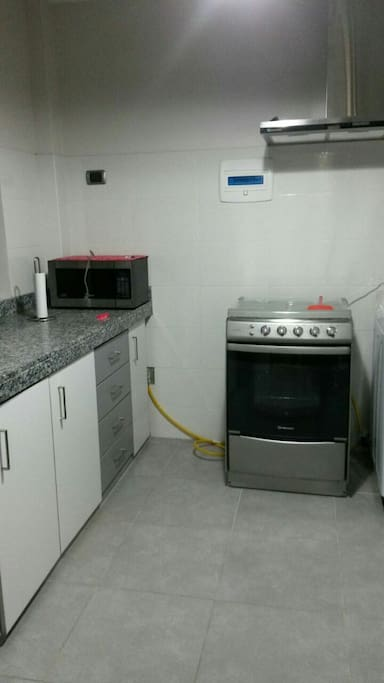 fully furnished kitchen. Fridge was not captured in this photo, but its in there, I guarantee.