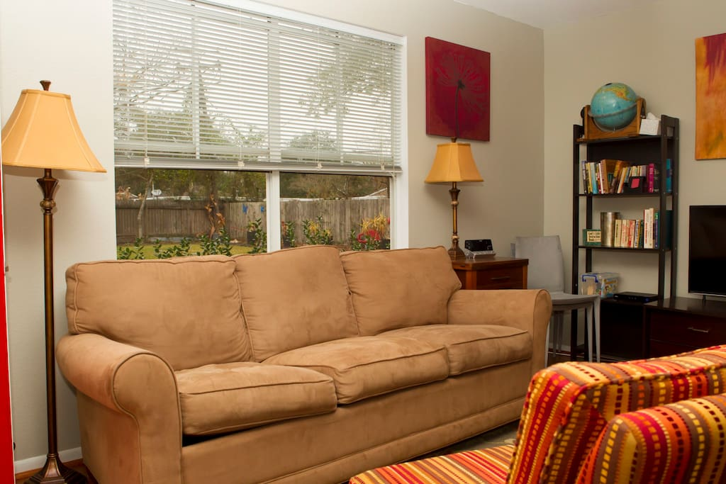 Relaxing sofa to sit on or pull out to sleep on.