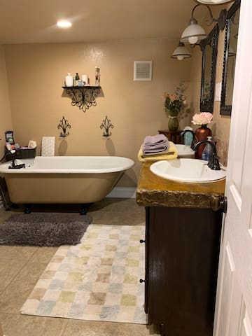 Private bathroom with tub, dual sinks, toilet and great lighting with dimmers.