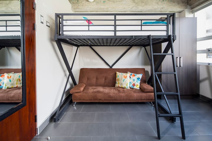 Full size bunk bed and a pull over couch.