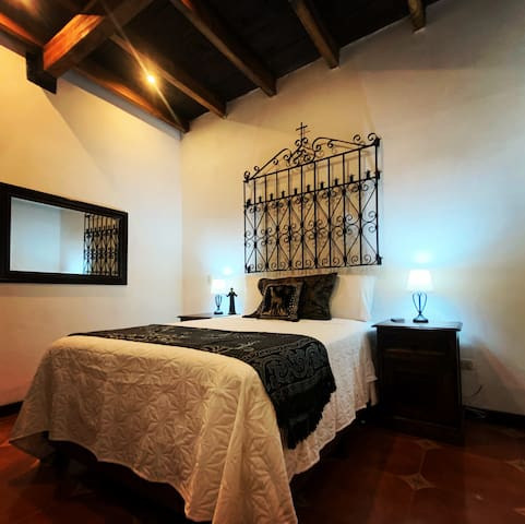 The Convent Room. Single bedroom with full-sized bed on the main floor. Includes TV.
