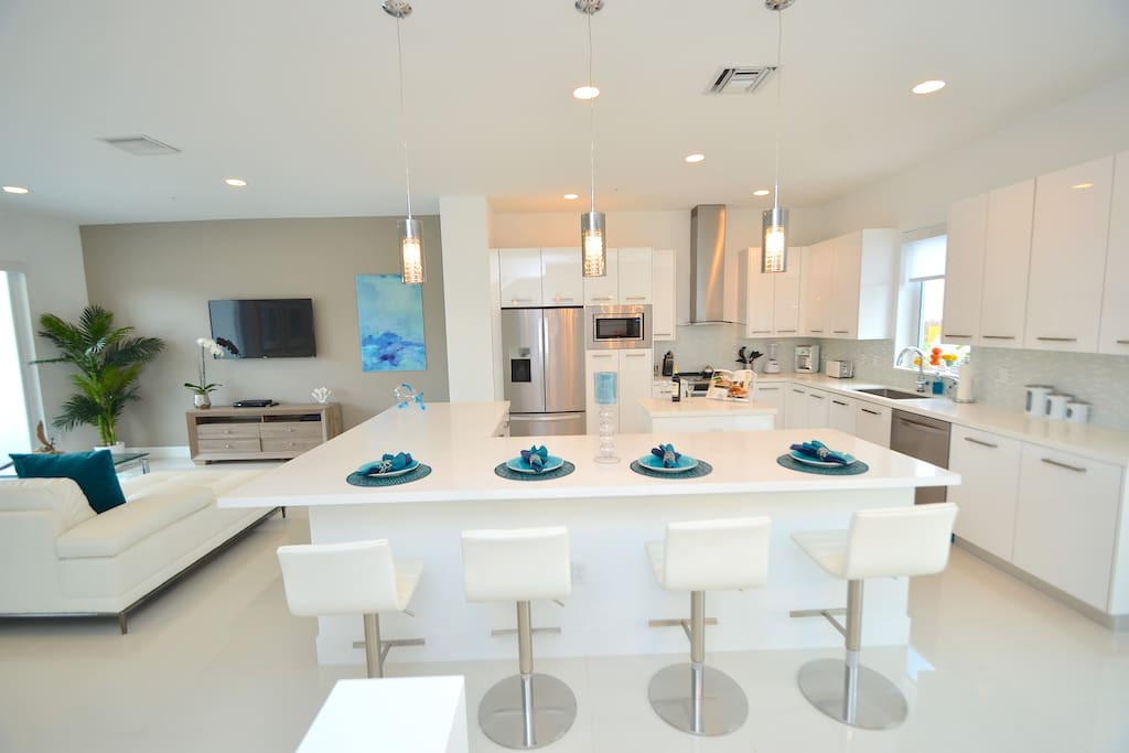 Spectacular Open Kitchen  (Fully Equipped) Overlooks Dining + Living Areas + Features Quartz Counter Dining...