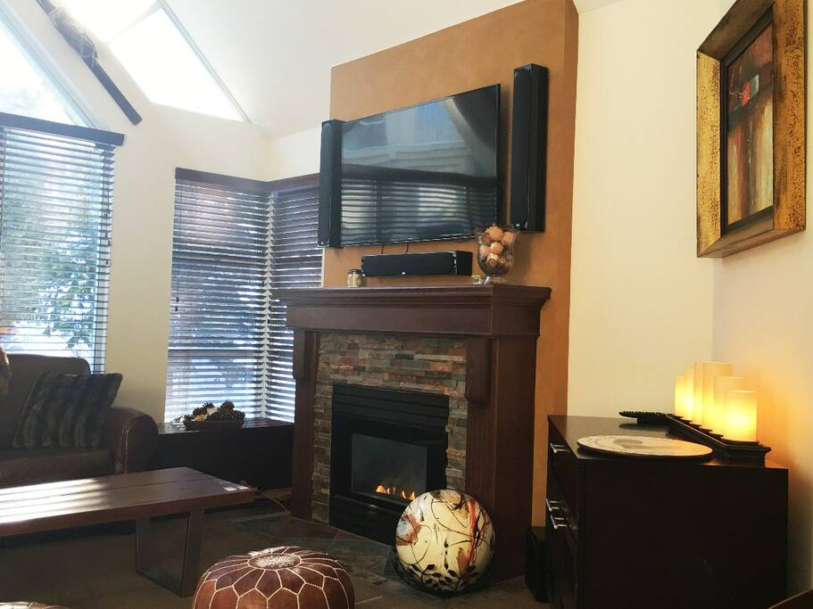 Cozy fireplace and high end entertainment center