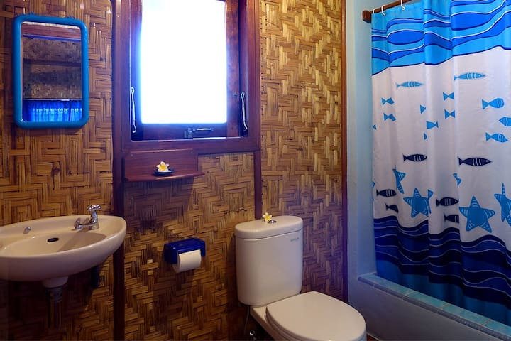 The en-suite bathroom has a western toilet, hand basin & shower. All linen and towels are provided.