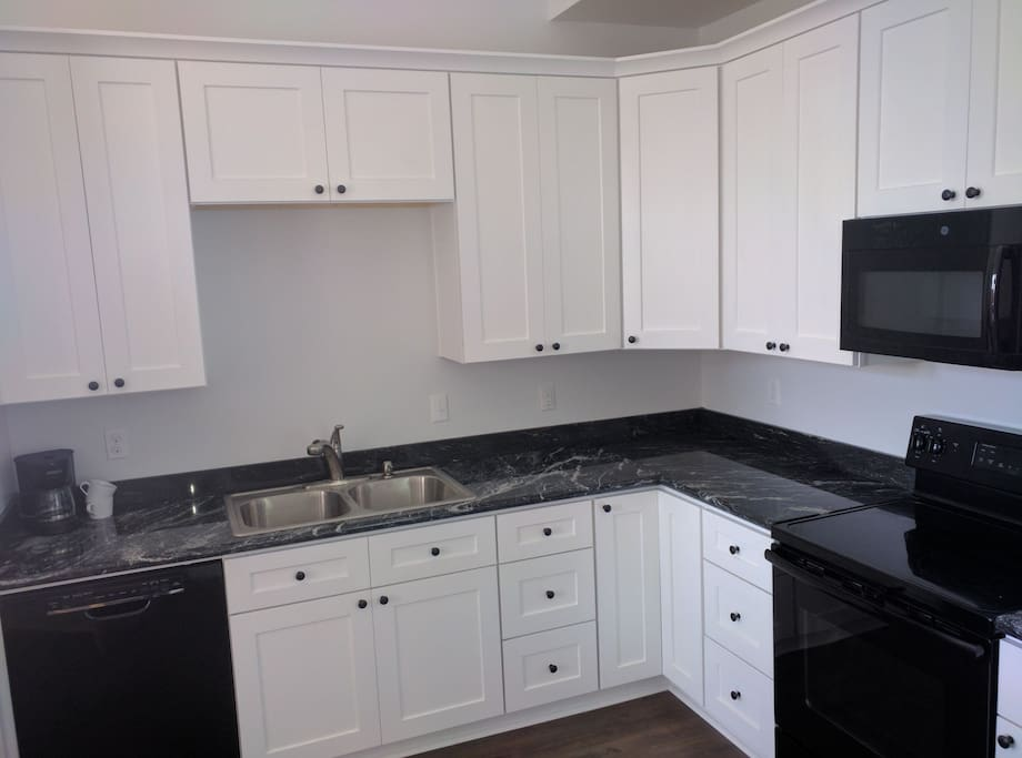 Full kitchen with fridge, dishwasher,stove, oven, & microwave. granite countertops. Coffee maker. Dishes and other cooking items not shown.