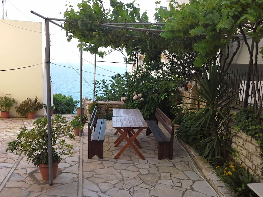 Grill and seating area in front of the apartment. Lovely flowers and Green are to relax and refresh after swimming.