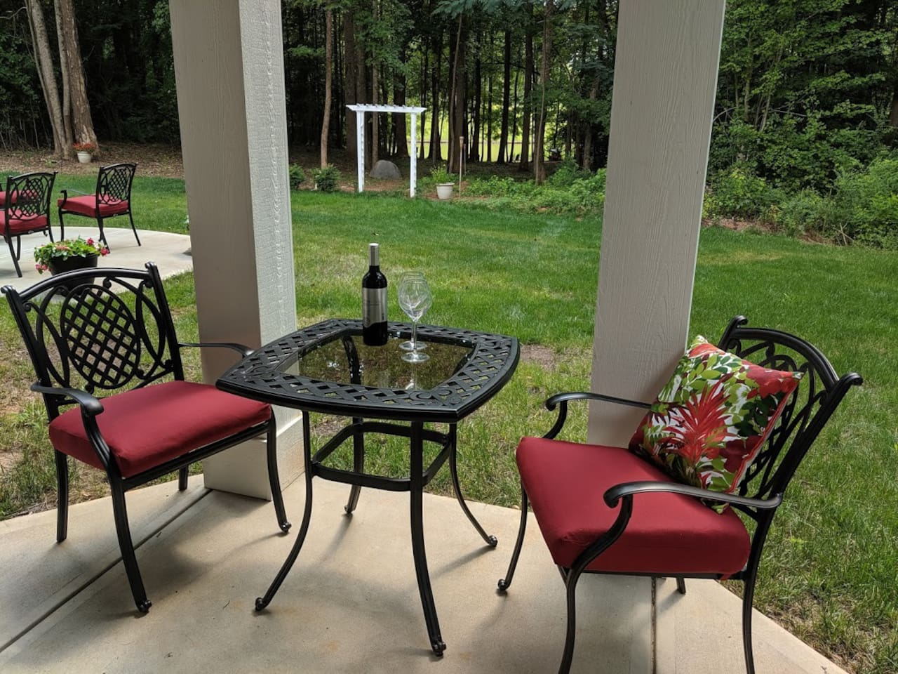 Front patio of studio with private entrance.  Direct lake access in rear through white pergola.