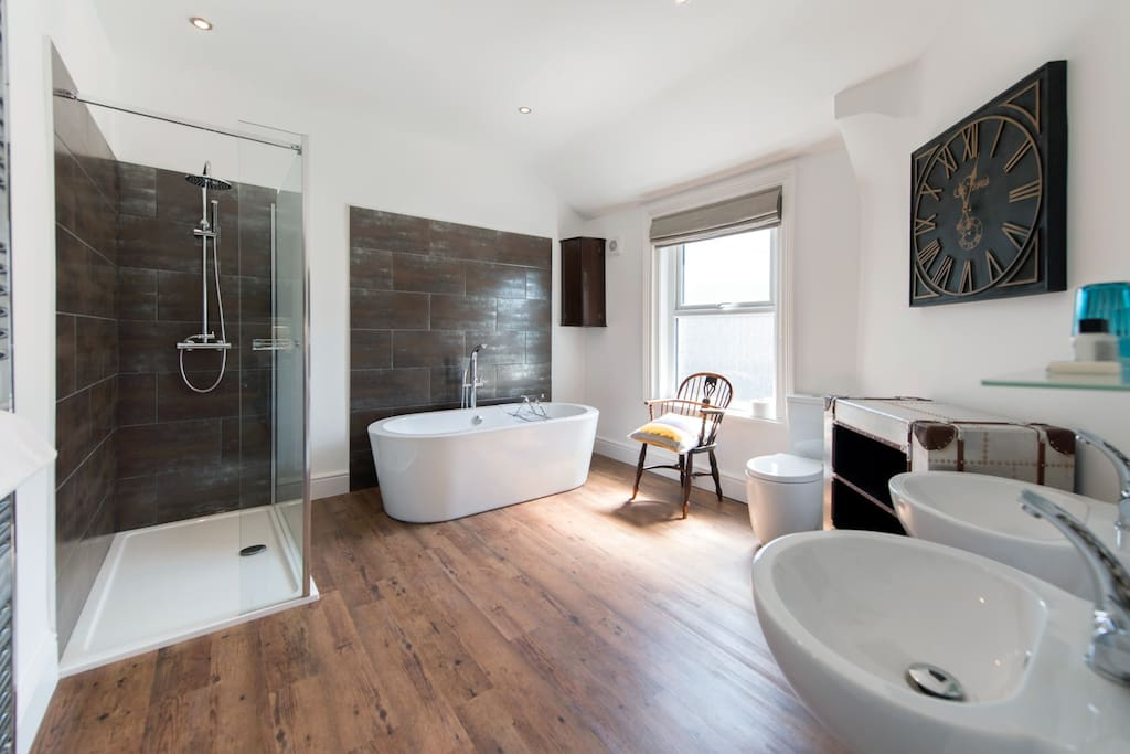 Beautifully appointed, spacious bathroom with free standing bath, double shower and two sinks.