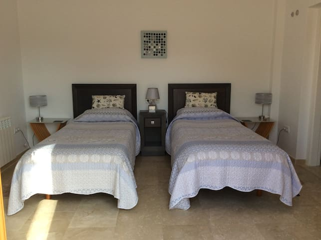 Bedroom, with twin beds or king size bed.