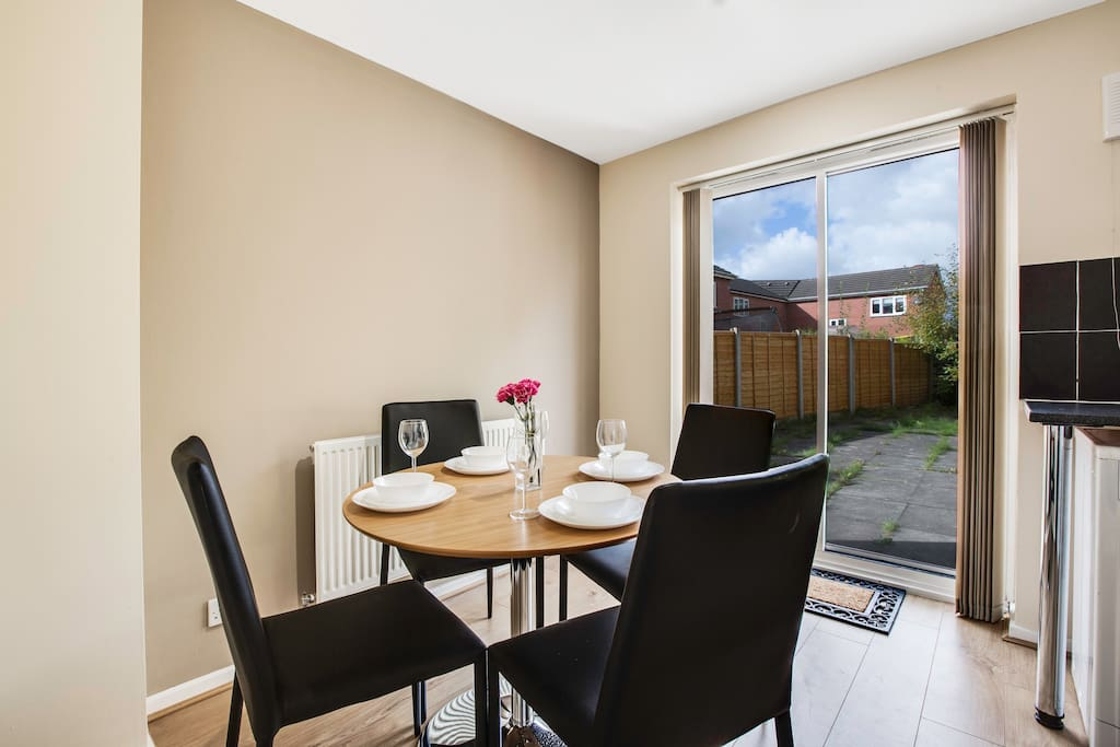 Modern dining area with garden view.