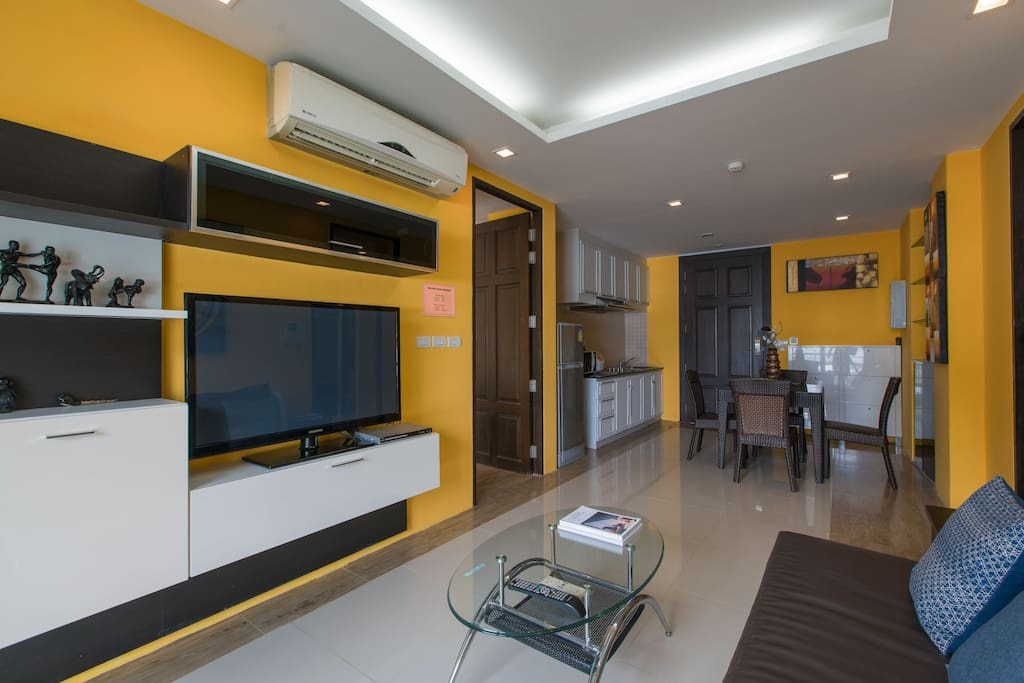 Living room with dinning area and kitchen