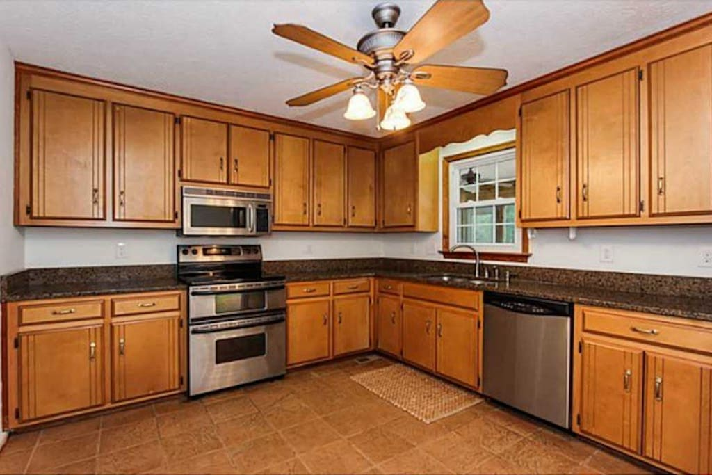 Large kitchen with granite and stainless.