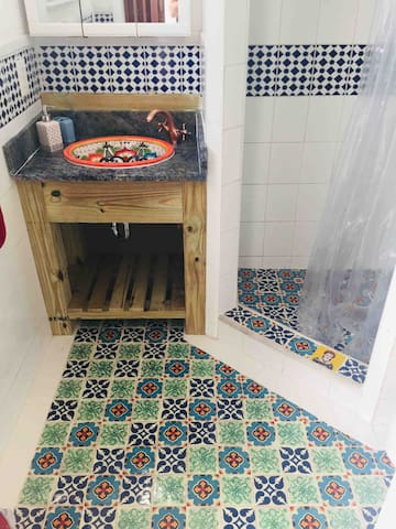 Welcome to your Funky Bathroom. Your are going to feel that you are taking a shower in Mexico with this beautiful and flamboyant Talavera tiles. We promise that you are going to smile every time and say What the Funk!