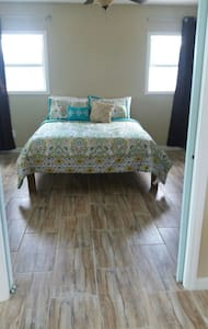 Suite with panoramic harbour views. - Great Exuma