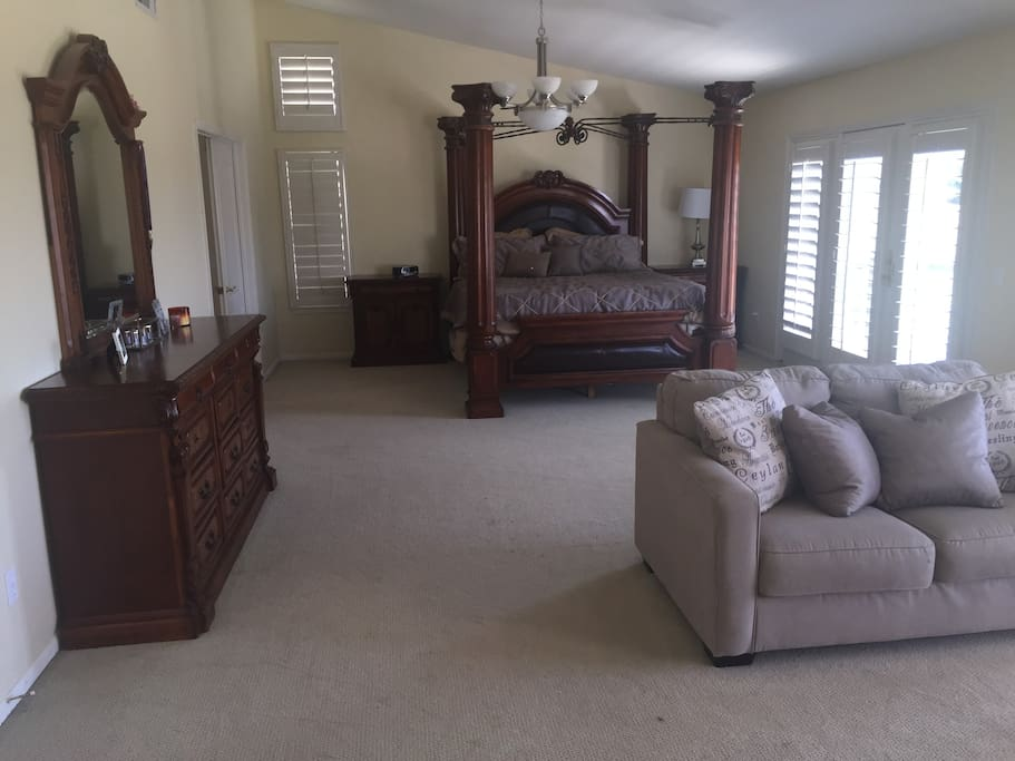 Master Bedroom with Love Seat and 70 inch HDTV
