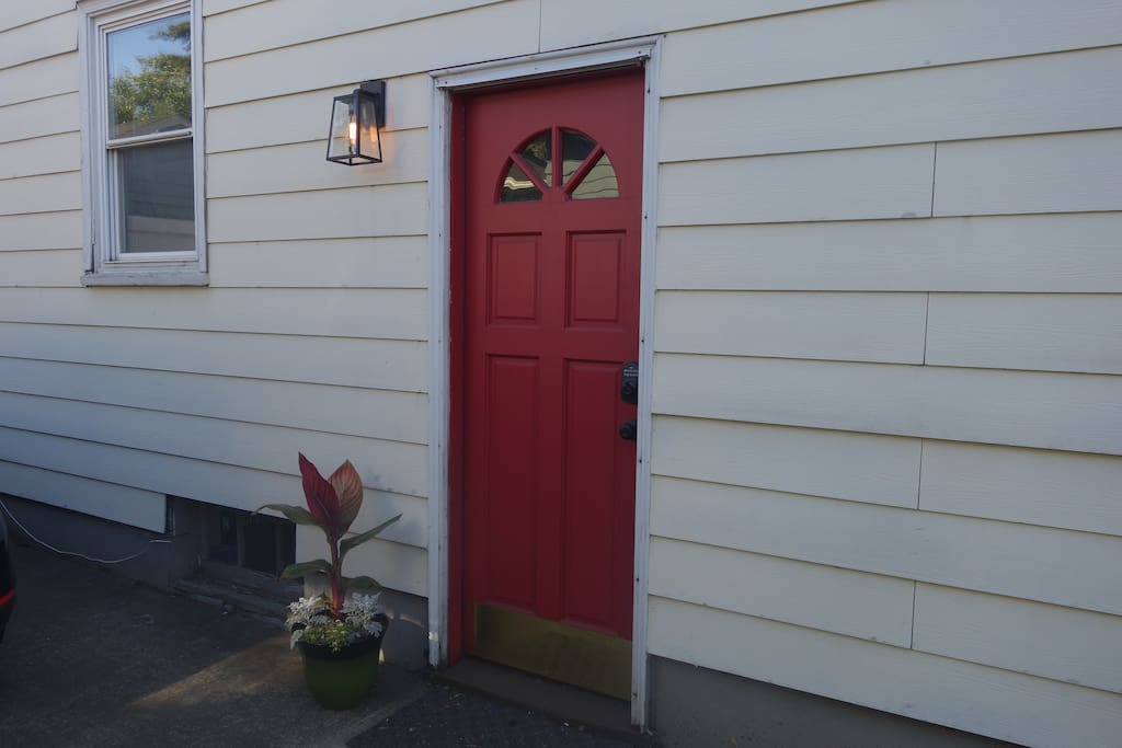 Side entrance - we'll provide you with a code to unlock the door.