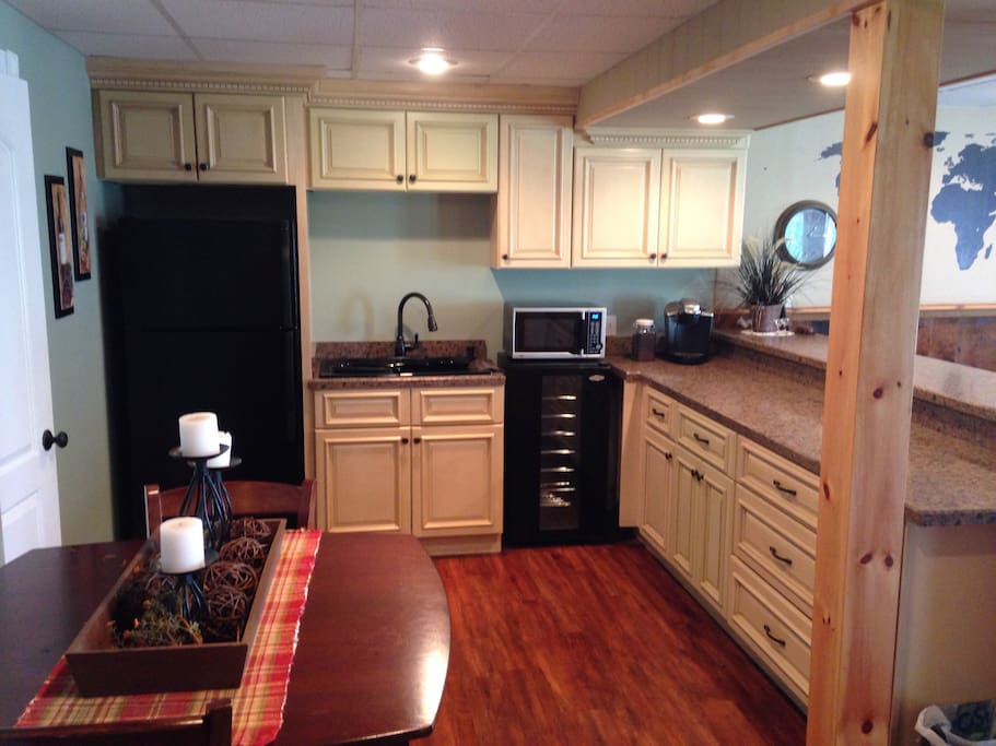 """Kitchen is mostly stocked. There is currently no stove/stovetop. We have an electric griddle to do more """"basic"""" cooking."""