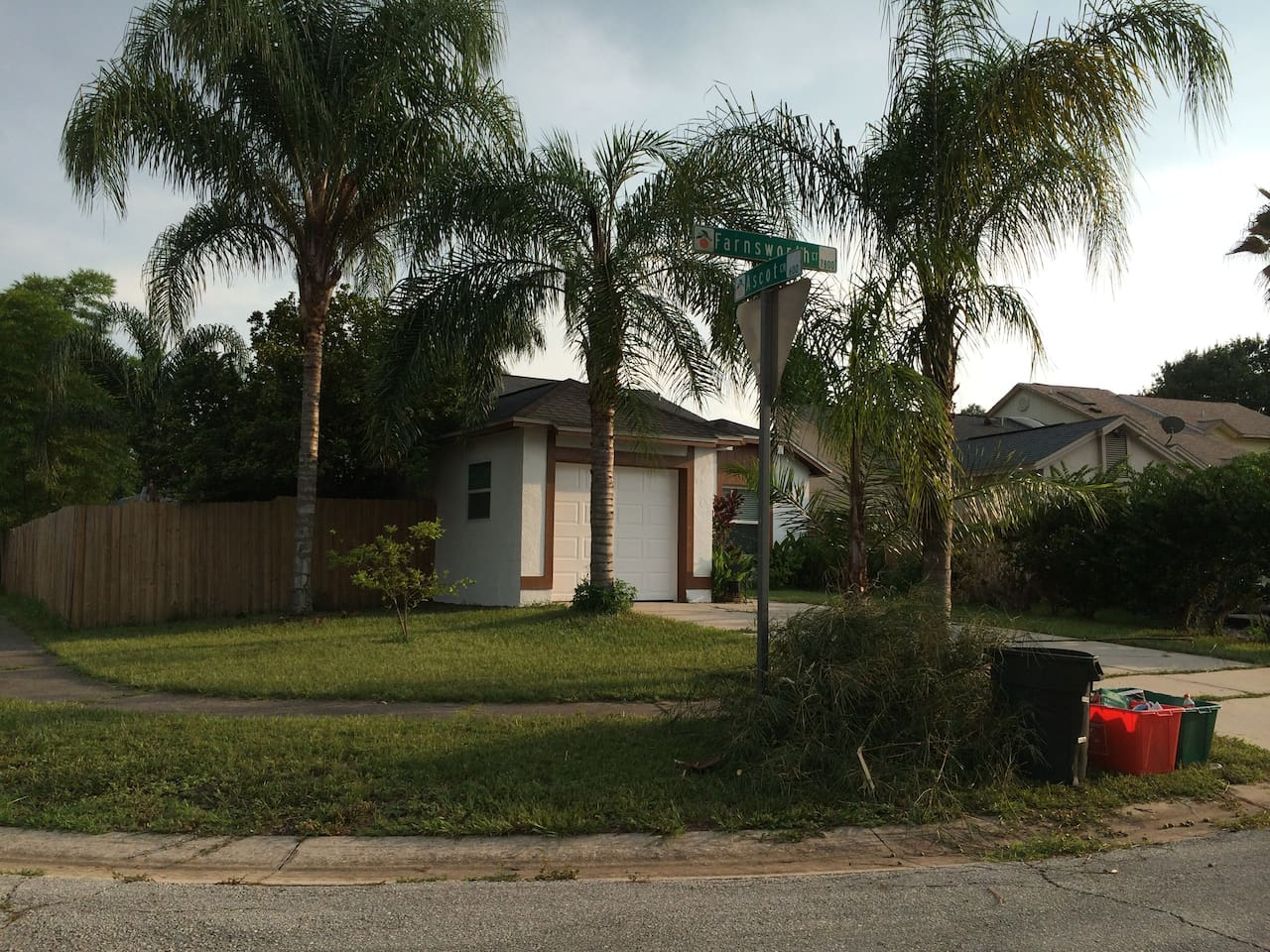 Corner Florida stucco house with plenty of parking and a privacy fenced in back yard.