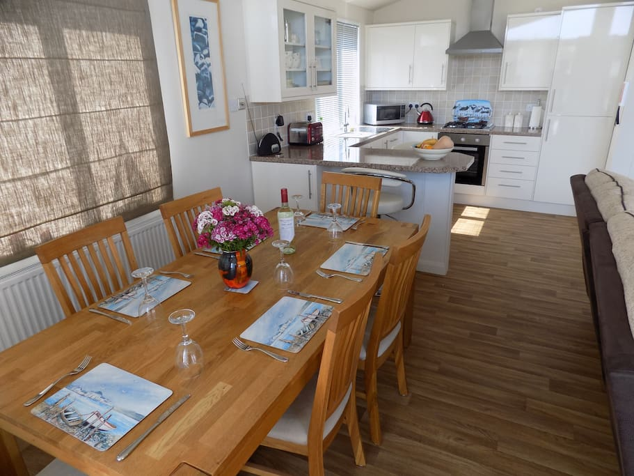Oak dining table and chairs-  spacious dining for six