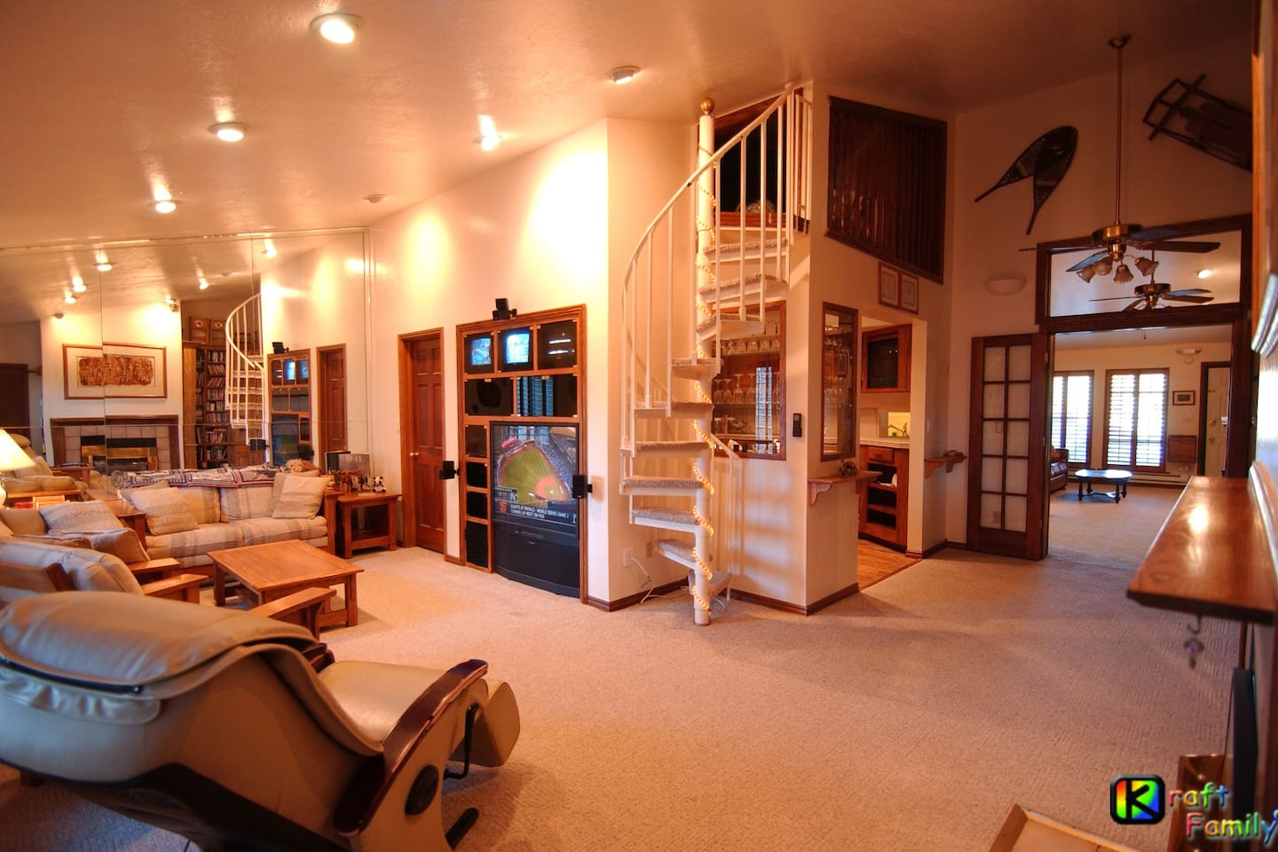 Living Room shared with other guests.  Five TV's in entertainment center with cable TV and DVD.