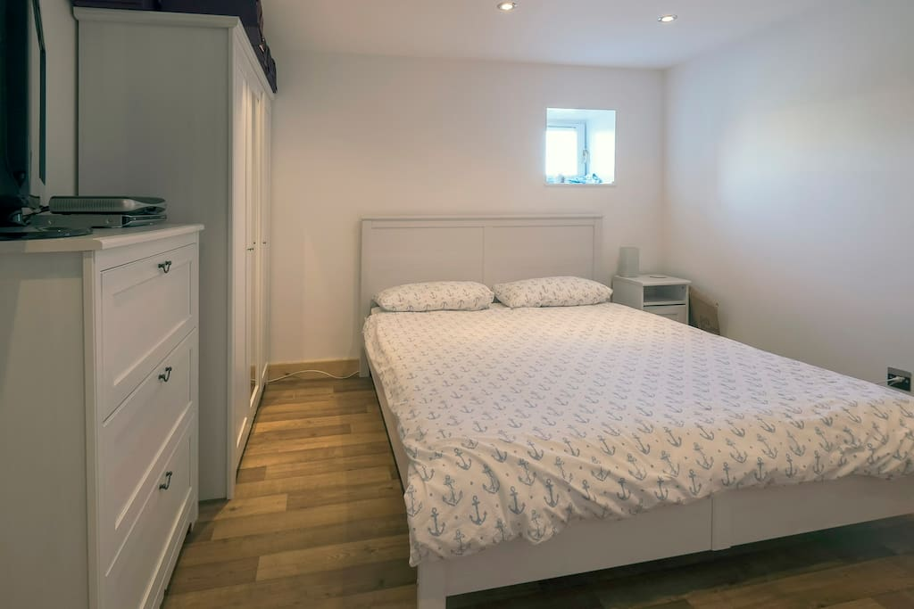 Bright double bedroom with space for a single blow-up mattress on the floor for a third person if necessary.