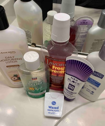 Sun care and basic skin/hygiene essentials are provided in the bathroom for guest use.