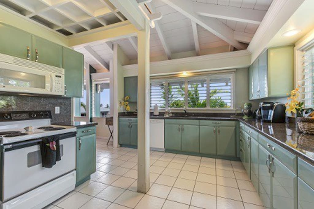 Large kitchen over looking ocean and garden