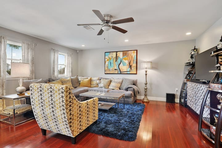Beautifully appointed family room. Large screen television. Lots of light through windows.